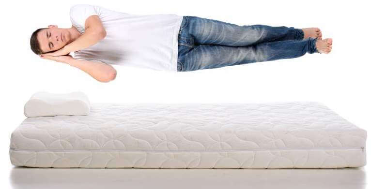 Young-man-sleeping-on-a-mattress-flying-during-sleep